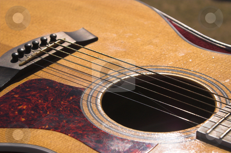 Guitar stock photo, A close-up view of an acoustic guitar. by Robert Byron