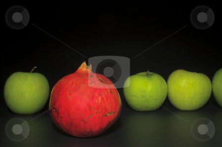 Multiple Apples and Pomegranate stock photo, Several Granny Smith apples and a delicious pomegranate. by Robert Byron