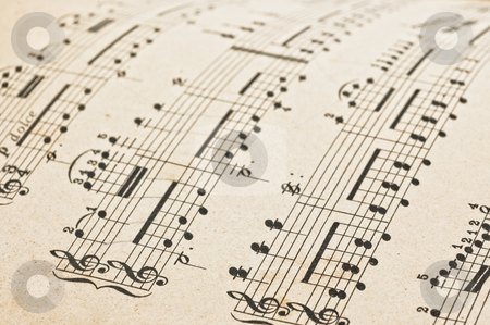 Music score stock photo, Antique music score, close up studio shot. by Pablo Caridad