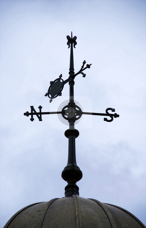 North to South stock photo, A photograph of the north and south points of the compass and the wind direction indicated by an arrow on a traditional weather vane by Philippa Willitts