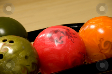 Bowling Balls  stock photo, Several bowling balls ready to be rolled down an alley. by Robert Byron