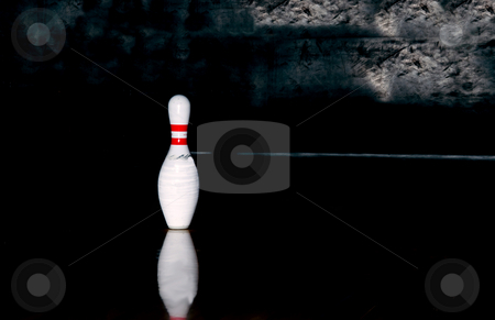 Bowling stock photo, A single bowling pin at the end of an alley. by Robert Byron