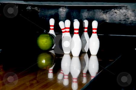 Bowling stock photo, Several bowling pins and a bowling ball. by Robert Byron