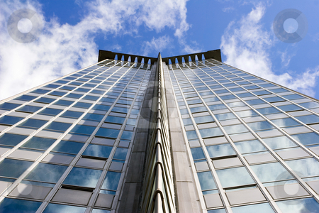 1950's Era Highrise Office Tower stock photo, Classic steel and glass tower against bright sunny blue sky and clouds by Mark S