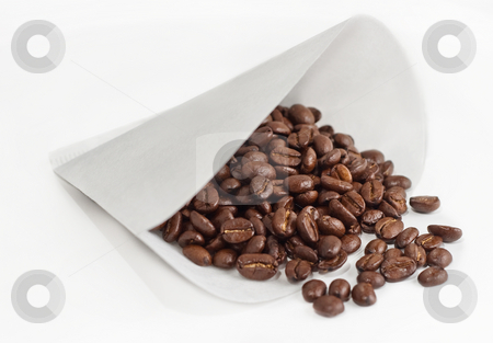 Whole Coffee Beans in Paper Coffee Maker Filter stock photo, Rich brown beans spill from cone filter by Mark S