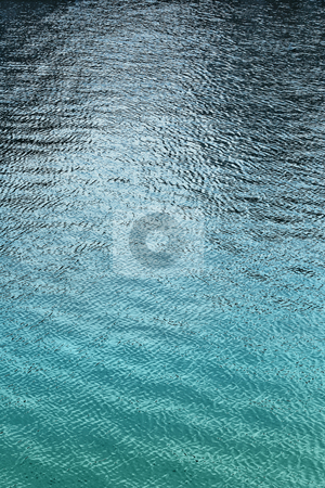 Rippled Blue Green Water Showing Depth stock photo, Calm lake or ocean water shallow and deep by Mark S