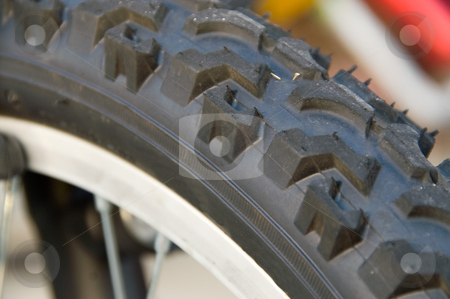 Bicycle Tire stock photo, A closeup image of a bicycle tire. by Robert Byron