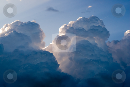 Storm Clouds stock photo, A background of large fluffy storm clouds by Richard Nelson