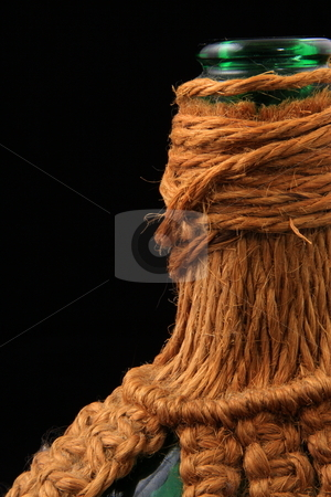 Macrame stock photo, Wine bottle with macrame covering by Jack Schiffer