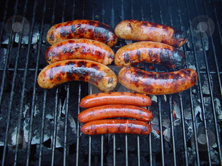 Sausage on the grill stock photo, Pork sausage and hot dogs on the grill by Jack Schiffer