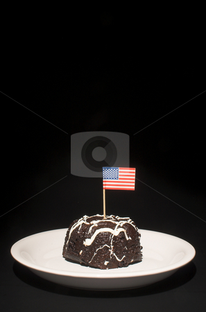American Flag Cake stock photo, A piece of chocolate cake with the American flag. by Robert Byron