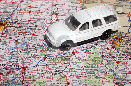 Travel America stock photo, A toy car travrling across an American road atlas. by Robert Byron