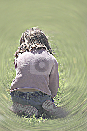 Little Girl Playing stock photo, A little girl playing in the grass. by Robert Byron