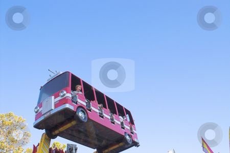 Fire Truck Kiddie Ride stock photo, A fire truck kiddie ride at a carnival. by Robert Byron