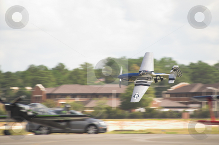 P-51 Mustang stock photo, A historic WWII P-51 Mustang in flight. by Robert Byron
