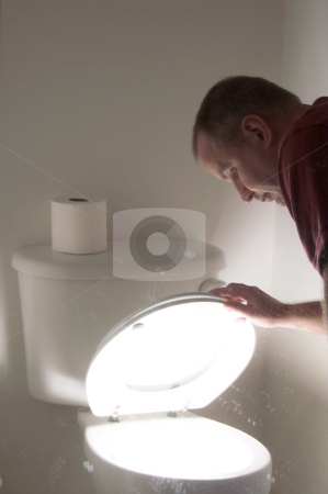 Toilet Terror stock photo, What lurks beneath the closed toilet seat after dark? by Robert Byron