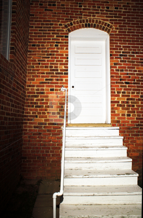 Back Door stock photo, The brightly lit back door of an old church. by Robert Byron