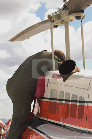 Helicopter Mechanic stock photo, A specialized mechanic working on a US Coast Guard helicopter. by Robert Byron