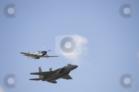 F18 Hornet and P-51 Mustang stock photo, A F-!8 Hornet and P-51 Mustang flying in formation. by Robert Byron