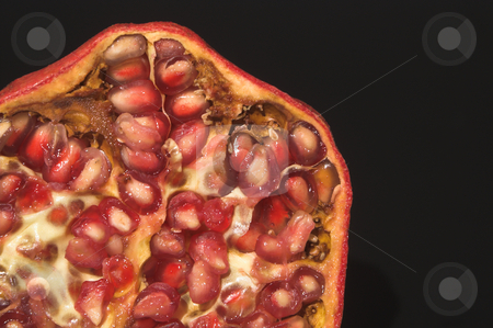Pomegranate  stock photo, The cross section of a fresh pomegranate. by Robert Byron