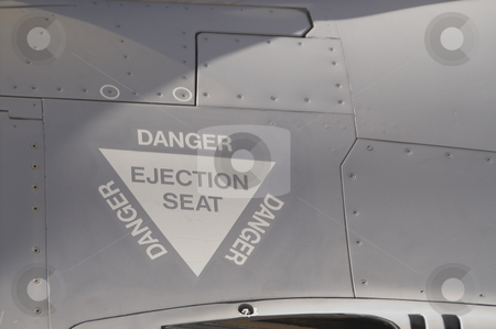 Ejection Seat stock photo, The ejection seat warning label on a fighter jet. by Robert Byron