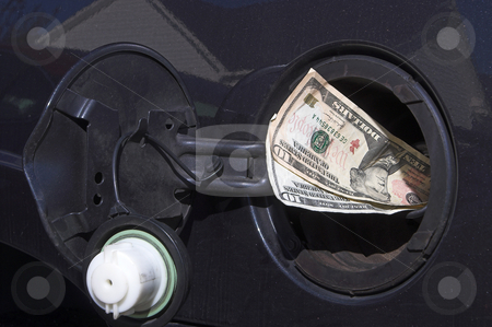 Gas Money stock photo, Pouring money in to the gas tank - the high cost of gasloline. by Robert Byron