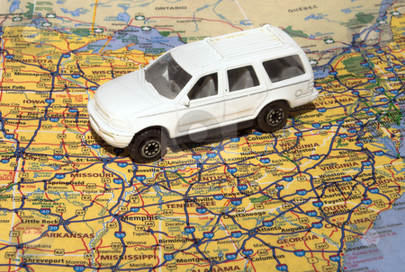 Travel America stock photo, A toy car traveling across an American road atlas. by Robert Byron