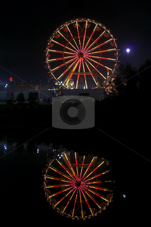Ferris Wheel stock photo, A large ferris wheel or big wheel at a fair. by Robert Byron