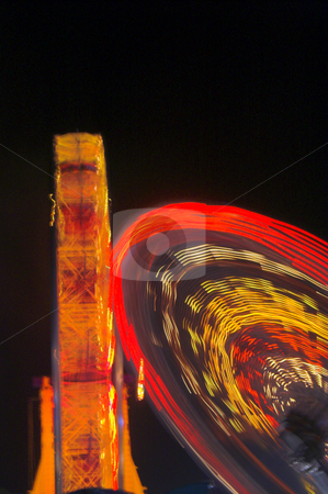 Abstract Ferris Wheel Lights stock photo, The motion blur of the lights on a moving ferris wheel. by Robert Byron
