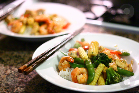 Chinese Stir Fry on White Plate stock photo, Photograph of Shrimp and Tofu Stir Fry on White Plate with Chopsticks; Shallow depth of field. by Andrei Harwell