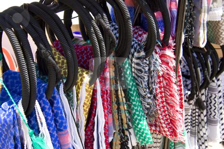 Arabian Keffieyeh stock photo, A rack of Keffieyeh, the Arabian headdress, hanging in a market stall near Petra, Jordan. by Andrei Harwell