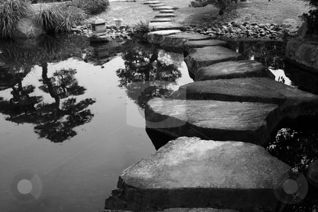 Stepping Stones stock photo, Stepping stones bridge across a pond in a Japanese Garden.  Black & White.  Himeji, Japan. by Andrei Harwell