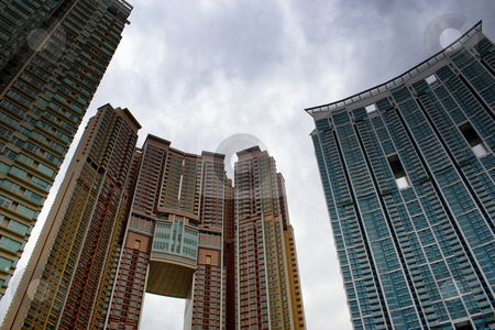 Tower Housing stock photo, New high rise housing towers in Hong Kong, China against a dramatic sky by Andrei Harwell