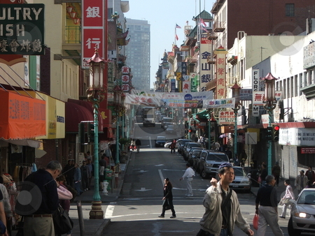 San Francisco Chinatown stock photo, San Francisco's Chinatown, a popular tourist destination, is about eight blocks long and primarily located on Stockton and Grant Avenues between Bush and Columbus.  Chinatown was rebuilt after the 1906 earthquake and it's architecture is an odd mix of Edwardian and Chinese design.  Dragon streetlights and Chinese signs on Grant Avenue help give the impression one has entered a different world. Souvenir shops abound this busy street (photo April, 2007). by Dennis Thomsen
