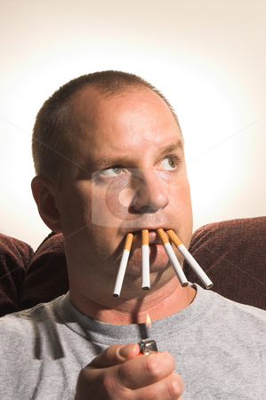 Chain Smoking stock photo, Concept of the negative effects of smoking. by Robert Byron
