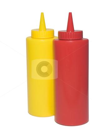Mustard and Ketchup Bottles stock photo, Pair of restaurant style mustard and ketchup bottles. by Robert Byron