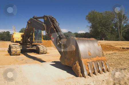 Industrial Excavator stock photo, An industrial excavator at a construction site. by Robert Byron