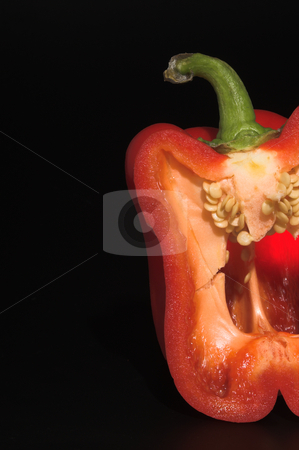Red Bell Pepper stock photo, The cross section of a fresh red bell pepper. by Robert Byron
