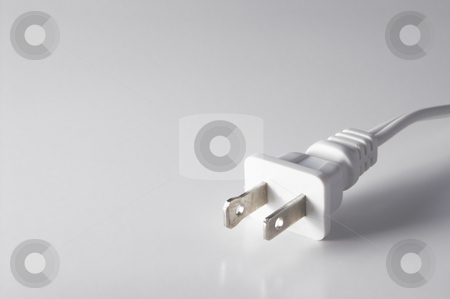 Plug stock photo, The plug on a cord of an electrical device. by Robert Byron