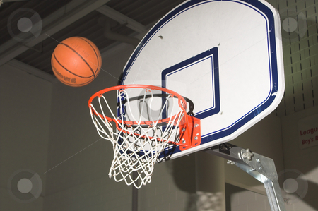 Basketball Shot stock photo, A basketball being shot into a goal. by Robert Byron