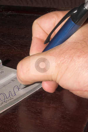 Writing a Check stock photo, A person making a payment with a check. by Robert Byron