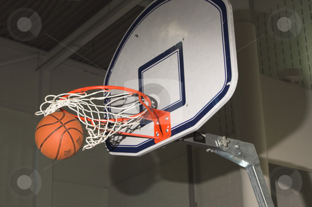 Basketball Swish stock photo, A basktball swishing through a basketball goal. by Robert Byron