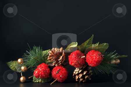 Christmas Spray stock photo, A Christmas spray with artificial ornaments, pine needles, pine cones and berries. by Robert Byron
