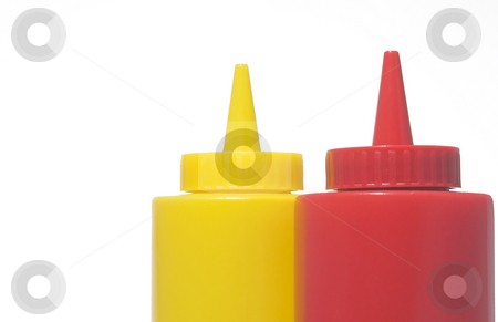 Mustard and Ketchup Bottles stock photo, Pair of restaurant style mustard and ketchup bottles. by Robert Byron