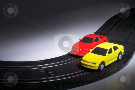 Slot Cars at Night stock photo, Two slot cars racing on a track at night. by Robert Byron