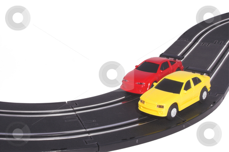 Slot Cars stock photo, Two slot cars racing on a track. by Robert Byron
