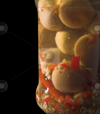 Jar of Mushrooms stock photo, A jar of tangy spiced processed champignon mushrooms. by Robert Byron