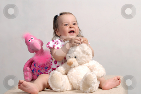 Baby and Toys stock photo, Laughing cute baby with teddy bear and rose flamingo isolated on white background by Valeriy Mazur