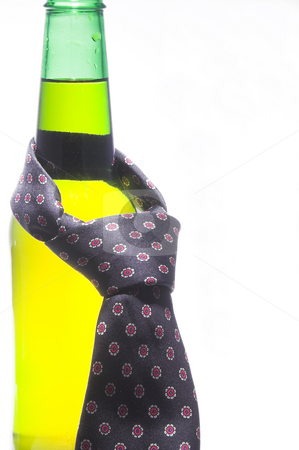 Beer Bottle with Necktie stock photo, A necktie draped around an ice cold beer. by Robert Byron