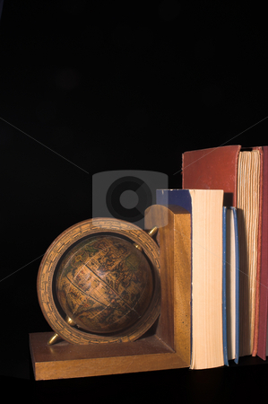 Globe Bookend stock photo, A globe on a bookend holding up books. by Robert Byron